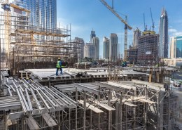 How is the construction and infrastructure market performing in emerging and developing markets?